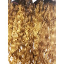 Curly golden brown blond hand tied weave